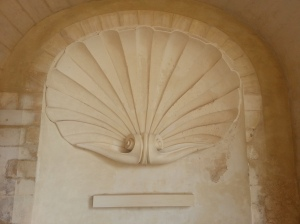 A large renovated 'pilgrim' scallop shell in the cloisters