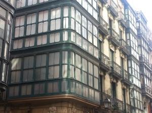 Encased upper balconies, a Spanish feature