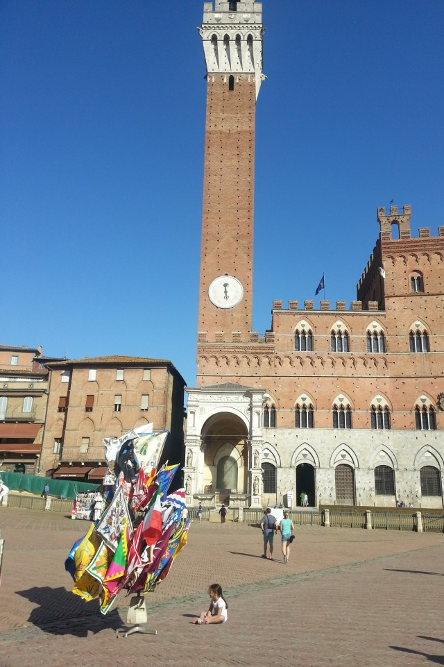 The colourful banners of the 17 'contrades' in Piazza del Campo